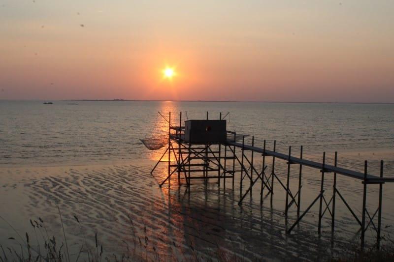 Cabane à carrelet et coucher de soleil à Fouras